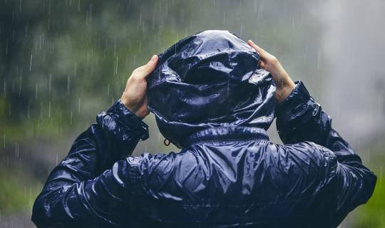 Person in water repellent coat